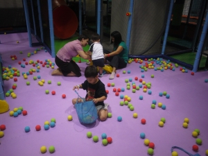 With friends picking up foam balls