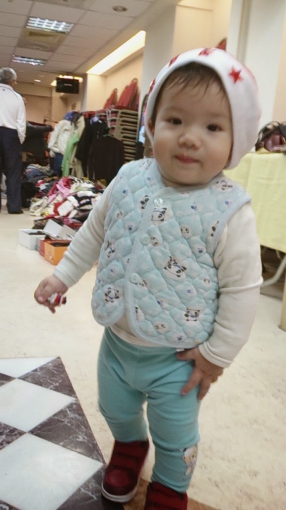 Little A all dressed up at a church Christmas bazaar