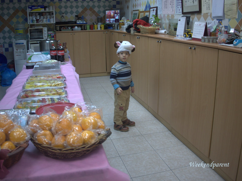 Big A dressed as a sheep before the nativity play.  Notice the trays of decadent cakes for supper.