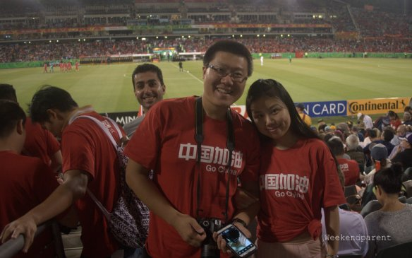 Cute China supporters (and someone who really wanted to be in the picture standing behind)