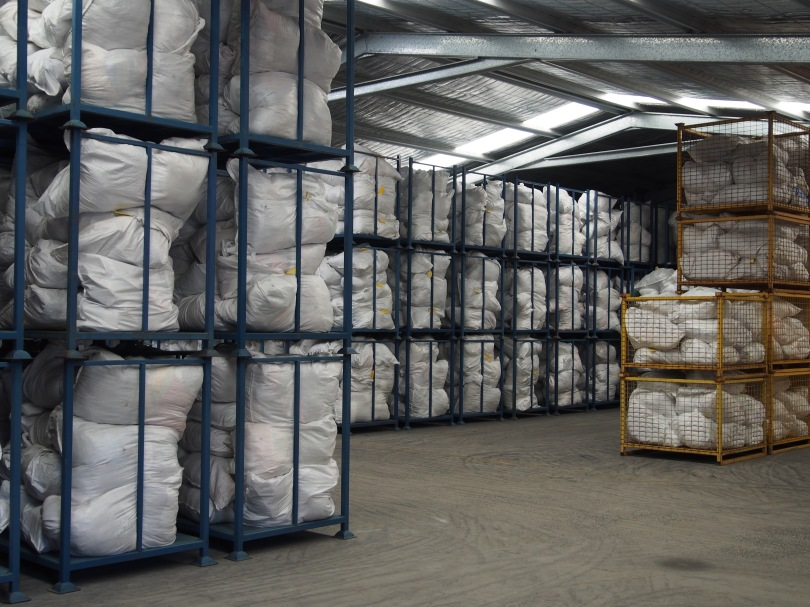 Bags of unsorted items in storage at the Vinnies Mitchell Distribution Centre