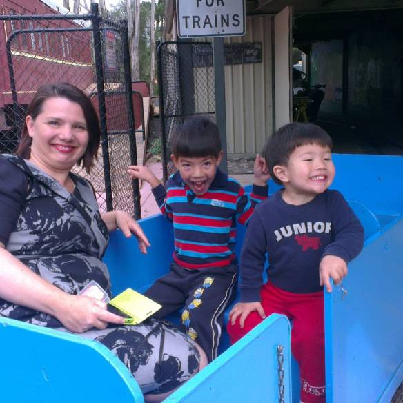Ms Frugal Ears with her two sons on the train