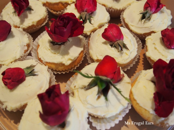 A collection of red roses on fairy cakes