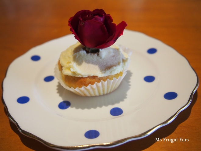 Red rose cupcake on a polka dot plate