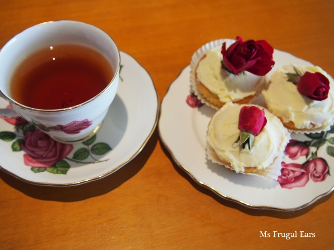 Rose painted China teacups and rose topped fairy cakes