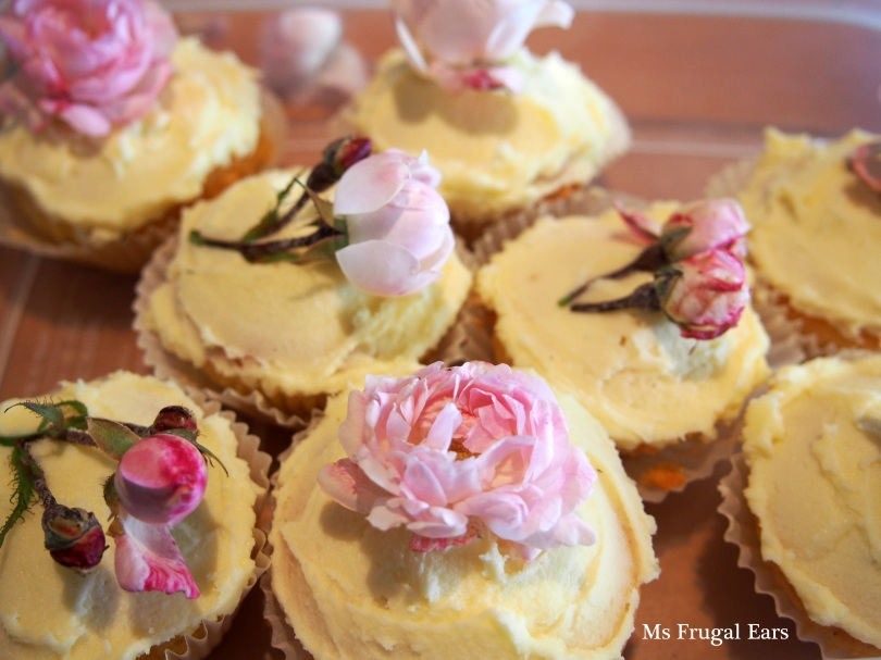 Pink rose topped fairy cakes