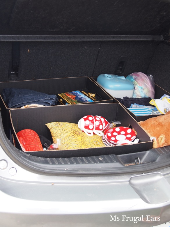 Car boot open with free things inside