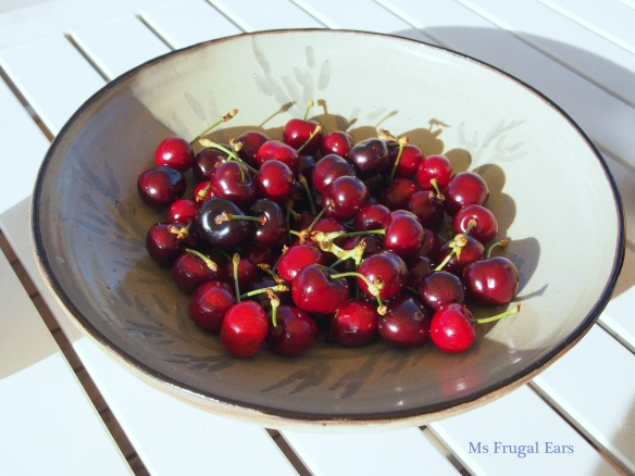 Cherries in pottery bowl