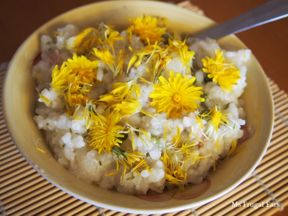 Dandelion jewelled risotto on a bamboo mat
