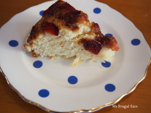 Cherry friendship cake on a polka dot plate