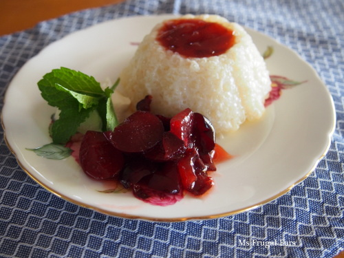 Sago pudding served with plum jam and fresh plums