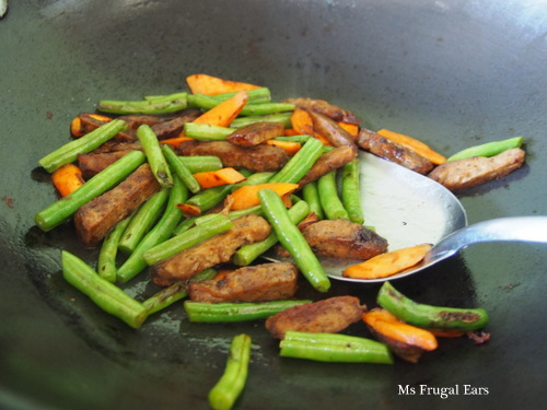 Stir-frying the vegetarian beef and vegetables