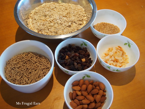 Ingredients for my homemade muesli: oats, linseeds, coconut crisps, dried fruit, almonds and processed bran