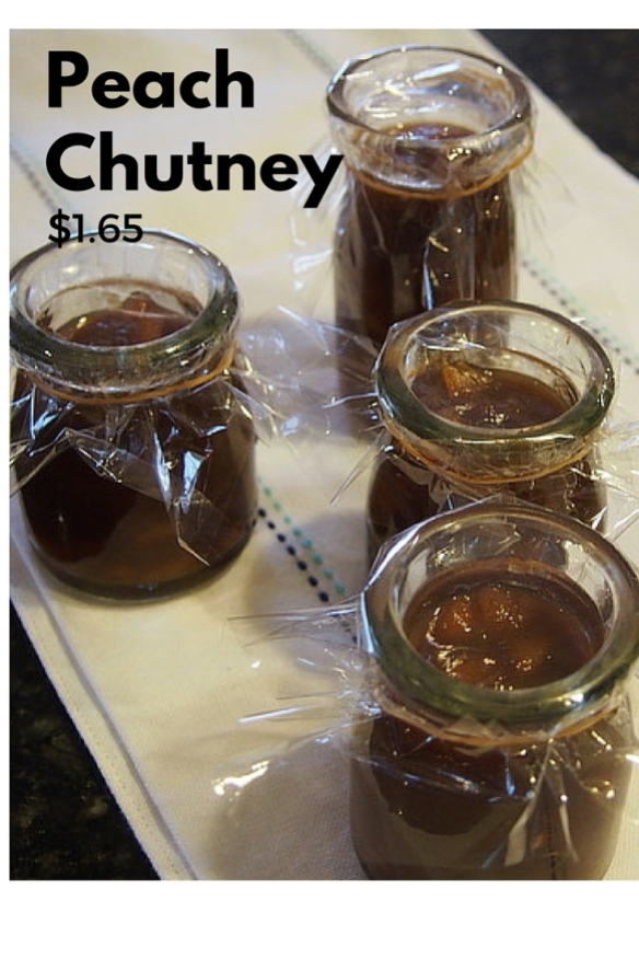 Four jars of peach chutney with plastic wrappers