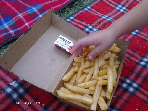 A child reaching for hot chips