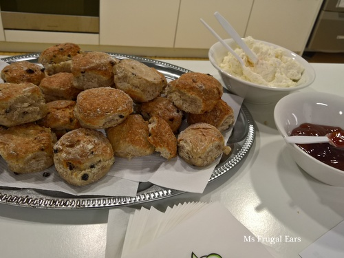 A plate of sultana scones with jam and cream