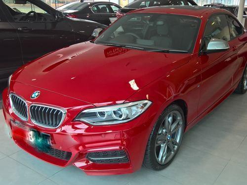 A red BMW sports car