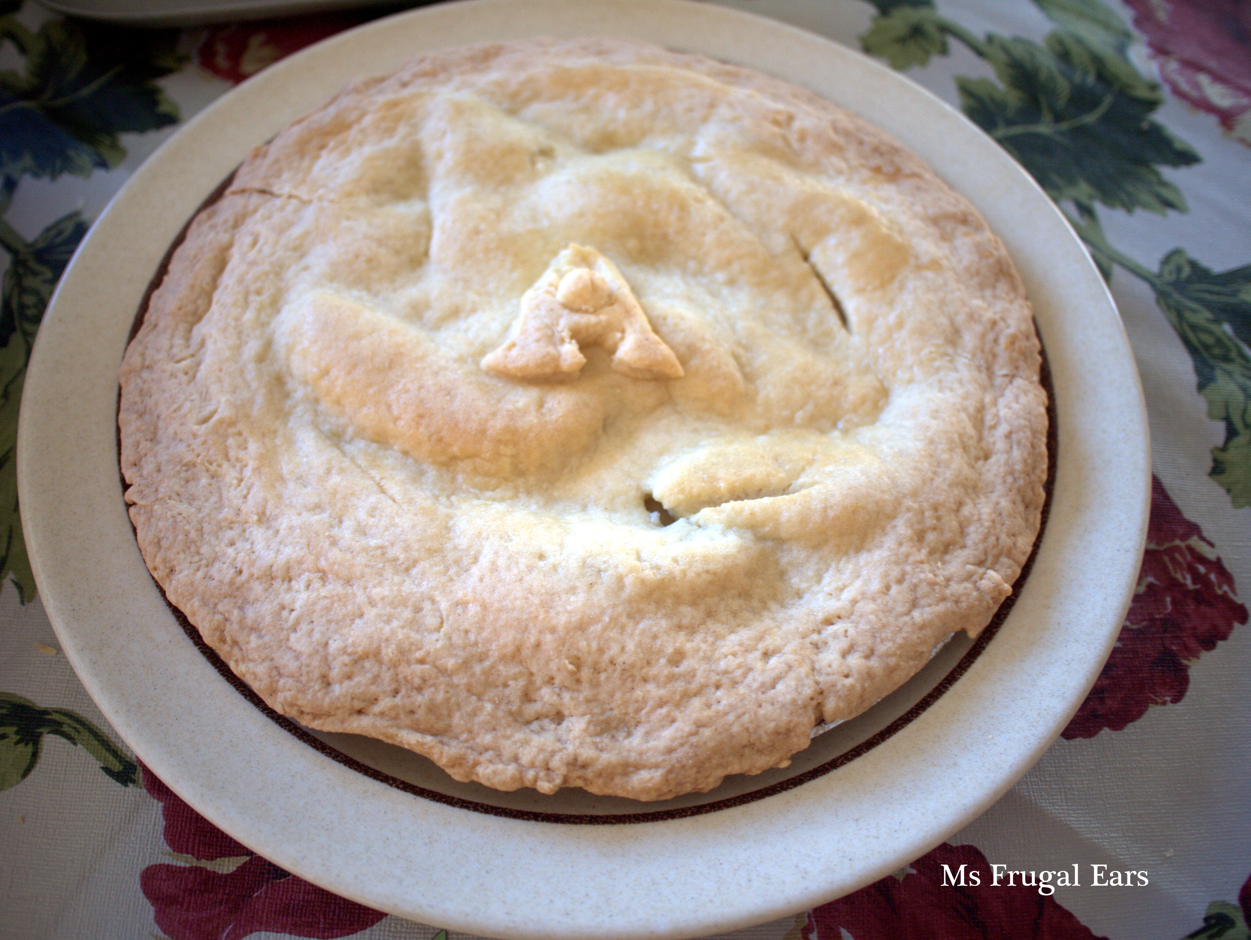 An apple pie with the letter 'A' on top