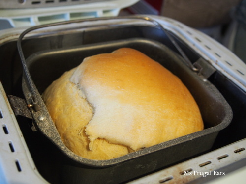 Freshly baked white bread still in the breadmaker