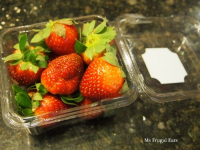 A strawberry container before