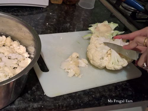 My housemate cuts her cauliflower into florets
