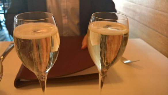 Enjoying a glass of Prosecco over a birthday celebration meal