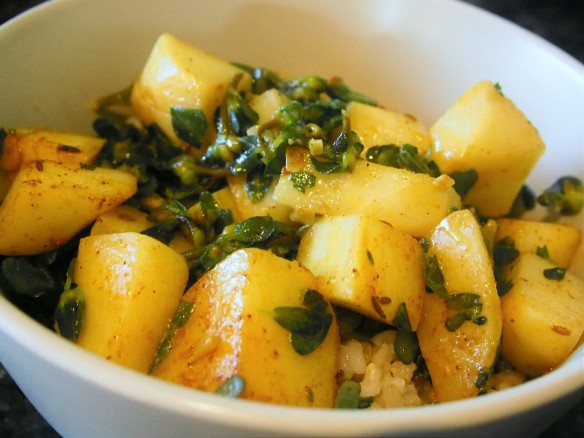 A bowl of potatoes and purslane