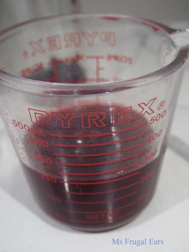 A jar of blackberry shrub
