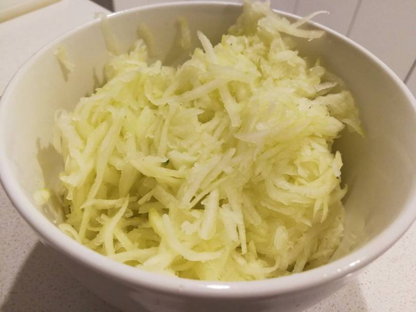 grated zucchini in a bowl