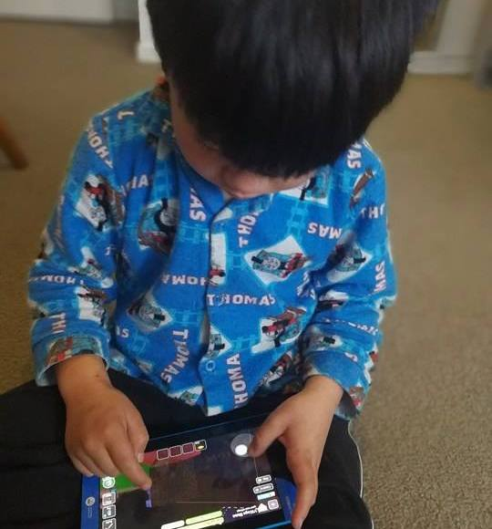 Child on a device
