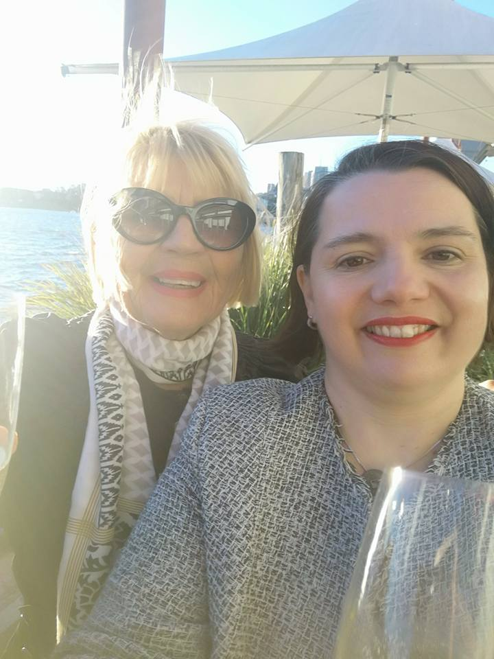 Mother and daughter - sharing a glass of sparkly on arrival in Sydney