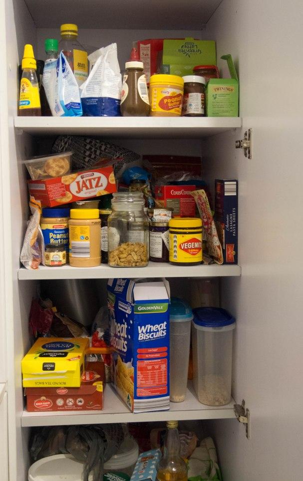 Cupboard full of food